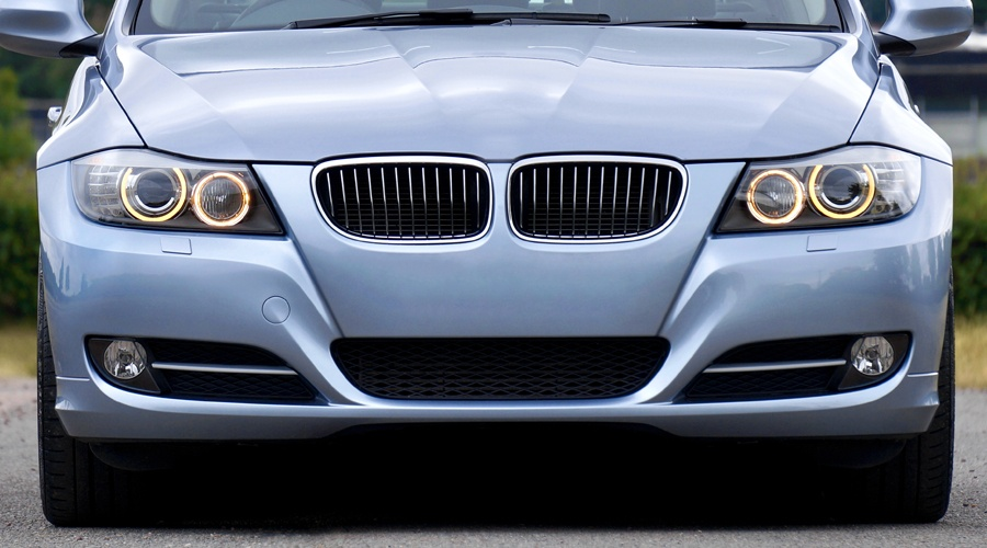front of car with lit headlights